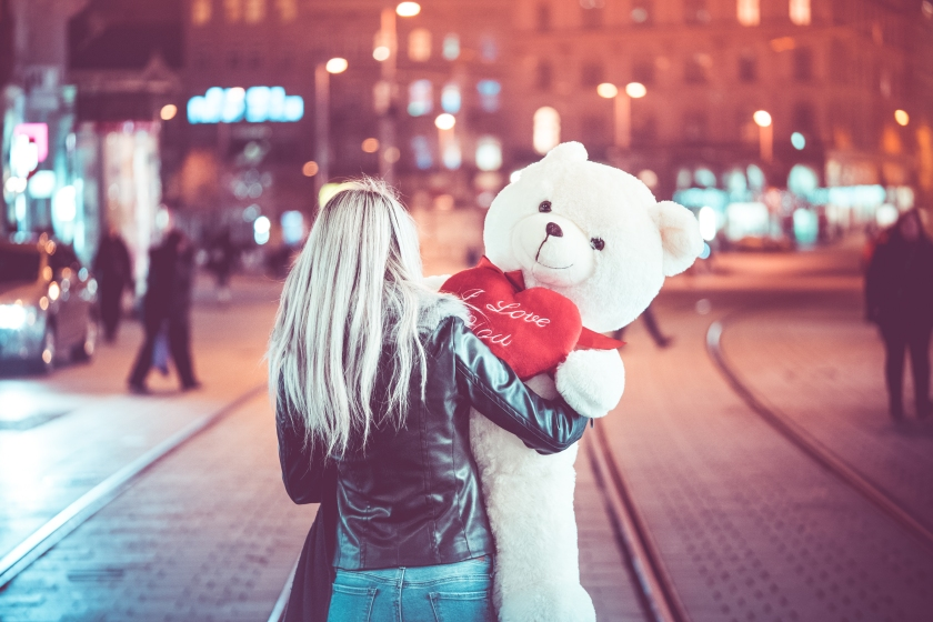 young-woman-walking-with-a-big-teddy-bear-at-night-picjumbo-com