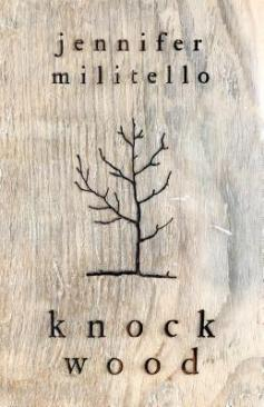 cover description: the outline of a scraggly tree is burnt into a woodgrain background.