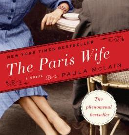 cover description: A woman in a blue dress sits at a cafe table with a man in a gray suit.