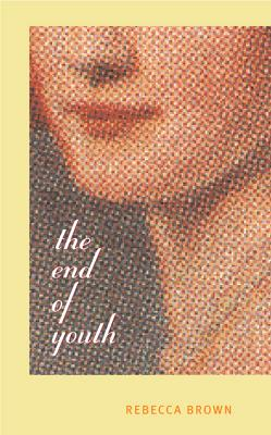cover description: A three-quarters view of the bottom half of a woman's face behind a matrix of tiny dots.